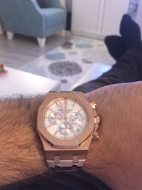 Gold and white chronograph wristwatch