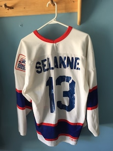 white,red, and blue 13 Selanne jersey shirt