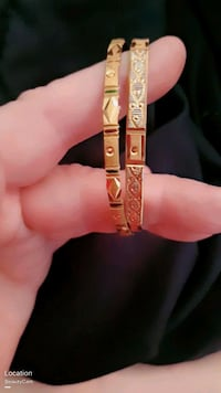 2 gold colored  bangles