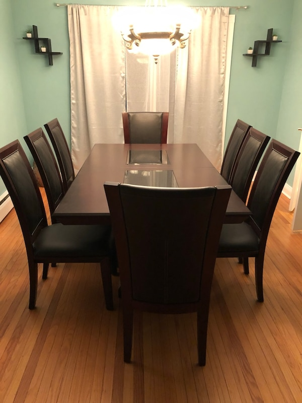 Beautiful Espresso dining room table set with server.