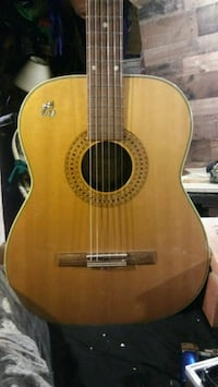 brown and black acoustic guitar Reno, 89511