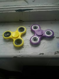yellow and purple hand spinners