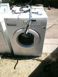 white front-load clothes washer Modesto, 95350