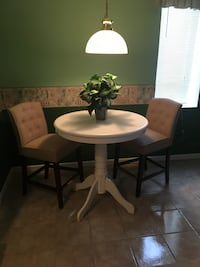 round white wooden pedestal table with two chairs Charles Town, 25414