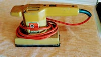 yellow and red corded power tool