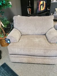 gray fabric sofa chair with throw pillow Bowmansville, 14026