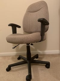 Big Office Chair with arm rests and wheels.