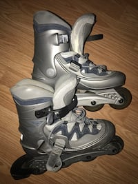 Pair of gray-and-black inline skates size 7/8 North Vancouver, V7J 2B1