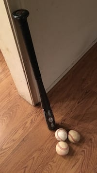 Baseball bat with three baseballs