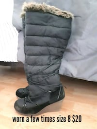pair of black leather knee-high boots Barrie, L4N 5A9