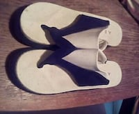 pair black and white Air Walk flip flops