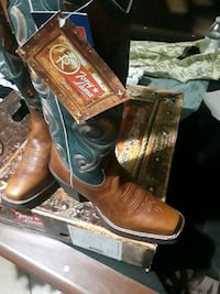 pair of brown leather cowboy boots Duncanville, 75116