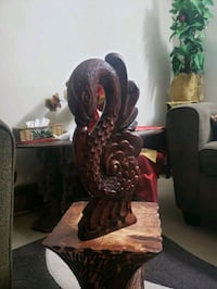 A swan carved on handcrafted wood