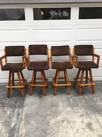 four brown wooden framed black leather padded chairs Long Beach, 90806