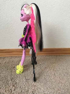 Monster high doll in black and pink dress