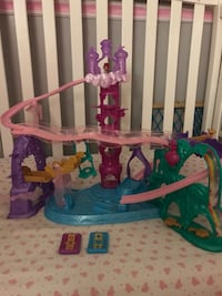 Toddler's multicolored plastic toy shimmer and shine magic carpet adventure
