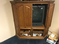 brown wooden TV hutch with flat screen television Troy, 63362