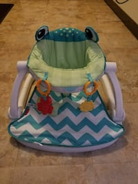 baby's blue and green Fisher-Price sit-me-up floor seat