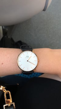 round silver analog watch with black leather strap Montréal, H2J 1L1