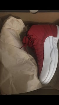 Unpaired red and white air jordan 12 shoe