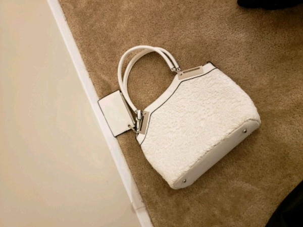 white and gray leather crossbody bag