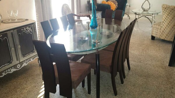 a74609b037e Used black metal frame oval glass dining table for sale in Cutler ...