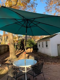 Patio Table with four chairs, umbrella and stand
