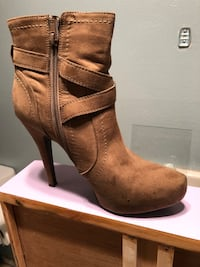 pair of brown leather heeled booties Covina, 91724