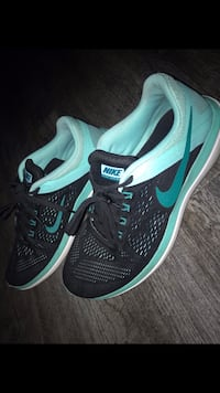 Pair of black-and-teal nike running shoes Fresno, 93727