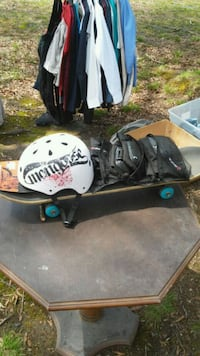 Skateboard with pads and helmet