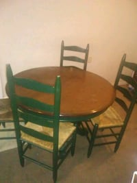 round brown wooden table with four chairs dining s North Little Rock, 72118