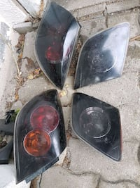 two black and red car headlights Laval, H7E 5B1