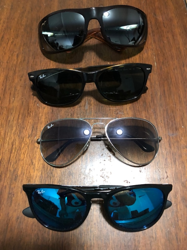 four black framed Ray-Ban sunglasses