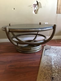 round glass top table with black metal base Vancouver, V5L 2Z7