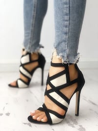 BRAND NEW BLACK AND WHITE HEELS - SIZE 7US 38EUR Laval, H7P 1Z7