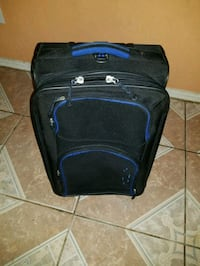 black and blue travel luggage 1197 mi