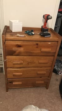 4 drawer wood dresser. I have the missing handle, just need to screw it back in. In good condition, except for a crack in the third drawer. Price is $50, but is negotiable Wilmington, 28403