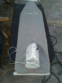 Ironing board and iron with holder