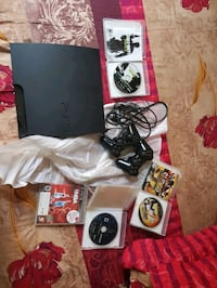 black Sony PS3 slim console with controller and game cases Astoria, 11106