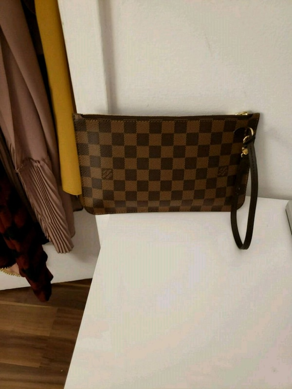 brown leather Louis Vuitton sling bag