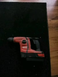 red and black hilti cordless hammer drill Triangle, 22172