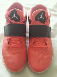 pair of red Nike basketball shoes Lancaster, 93535