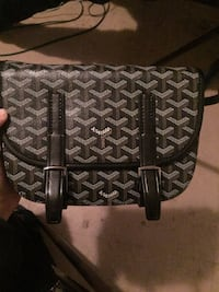 black and gray Goyard leather bag