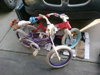 toddler's pink and white bicycle