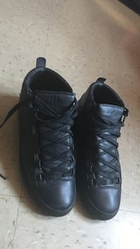 Pair of black high-top sneakers New York, 11212