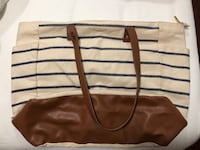 brown and white leather tote bag Laredo, 78041