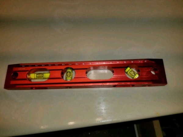 red and black electronic device 7ebc1594-cf33-415a-9b69-eaee6ed57f58