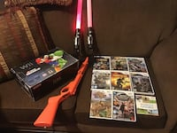 Black Nintendo Wii Mario Edition with 9 Great games + Gun + 2 Light sabres + 2 Controllers + 2 Nunchucks + all Cables + Netflix and YouTube. Excellent cond. Barely used. $140 takes Calgary, T2A 7S7