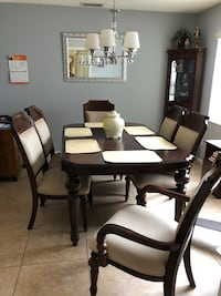 Dining room table w/ 6 chairs and 2 additional length inserts Saint Cloud, 34769