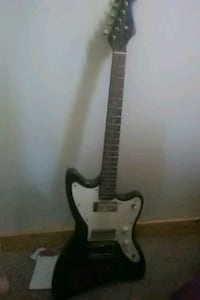 white and black electric guitar Broken Bow, 68822